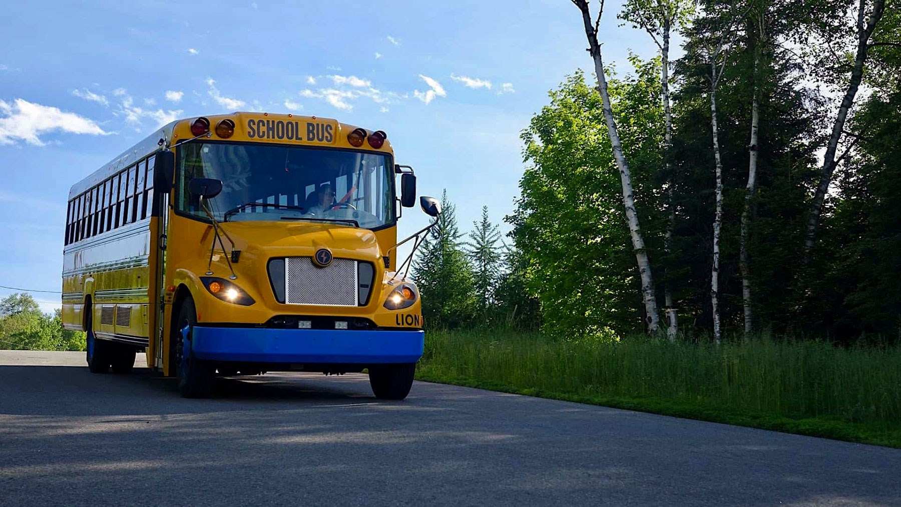 a photo from MA pilot program shows electric school buses can cut GHG emissions in half